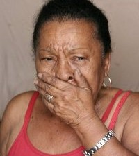A woman cries during her eviction from Favela do Metrô
