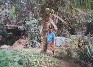 Dona Rita in her organic fruit & veg garden