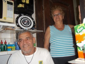 Seu Veto and his wife at their bar in Providência