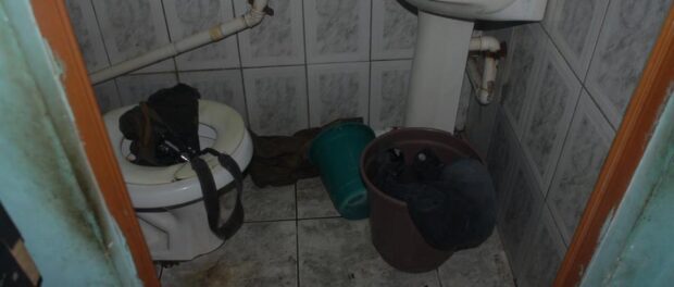 Bira's work equipment, a photographic camera, was found inside the toilet.