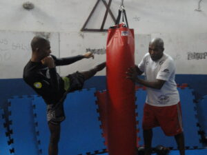 Martial arts teacher Zé Milton trains with Penca.