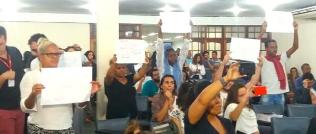 Residents hold banners calling for an end to violence.
