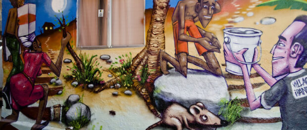 Graffiti on homes tells the story of the communities of Pavão-Pavãozinho and Cantagalo
