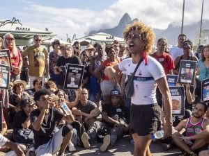 """Performance by Bando Cultural Favelados from Rocinha during the """"Stop Killing Us"""" demonstration. Photo: Daiana Contini"""