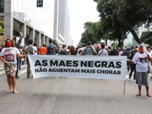 """""""Black Mothers Cannot Take Crying Any More,"""" banner at June 2020 march against racism and state violence. Photo: Luna Costa"""